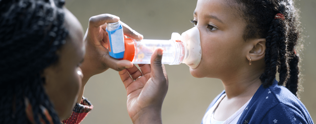 A child receiving an inhaler